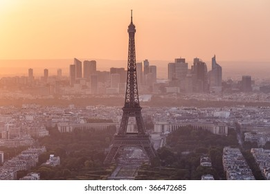 Eiffel Tower and skyline of Paris, France with golden sunset light and new houses in the background