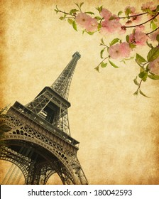 Eiffel Tower in spring time, Paris, France. Photo in retro style. Added  paper texture.