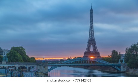 Eiffel Tower sunrise with boats on Seine river and in Paris, France. View from Grenelle bridge