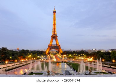Eiffel tower at sunset with lights on, in Paris