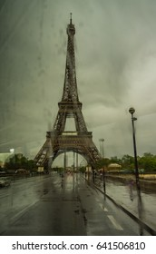 The Eiffel Tower through a bus window on a rain filled Paris day