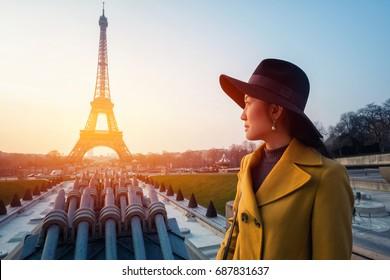 Eiffel Tower tourist posing smiling by Eiffel Tower, Paris, France