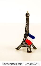 Eiffel Tower toy miniature on white background