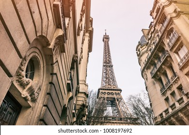 Eiffel Tower view from cozy street in Paris, France