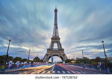 Eiffel tower view during the twilight, long exposure image with cloud and light trails
