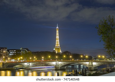 Eiffel Tower view from Invalides during the cloudy night, long exposure image
