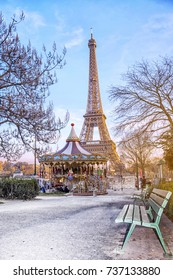 The Eiffel Tower and vintage carousel on a winter evening in Paris, France.