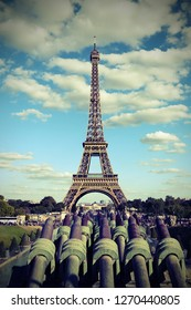 Eiffer tower from Trocadero Quartier in Paris and the cannons with old vintage toned effect