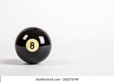 Eight Ball on a plain white background lower left corner