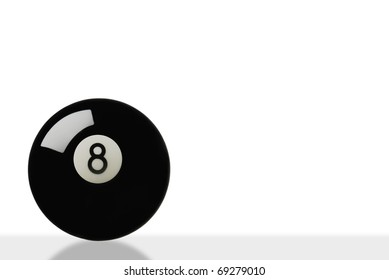eight ball on white with slight reflection