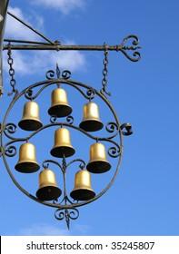 The eight bells/Pub sign illuminated with sun