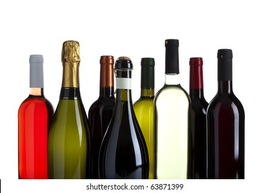 eight bottles of wine, champagne and prosecco, no labels, isolated on white