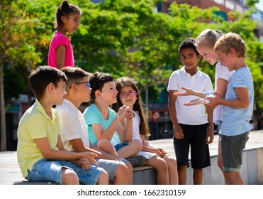 Eight children are talking about play on walk in the park