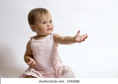 eight month baby. little girl in thr pink dress