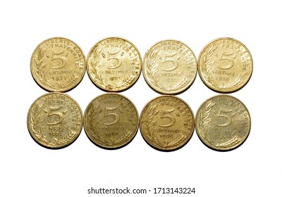 Eight old French 5 centime coins on a plain white background