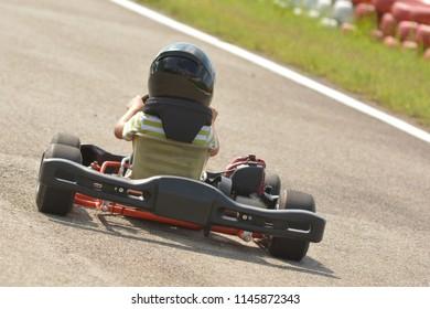 eight year old boy drives go-kart