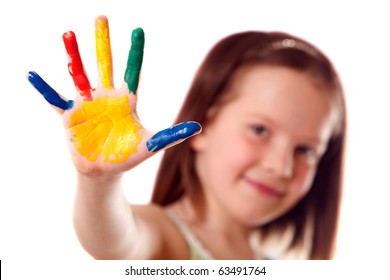 Eight year old girl with hand painted in colorful paints ready for hand prints