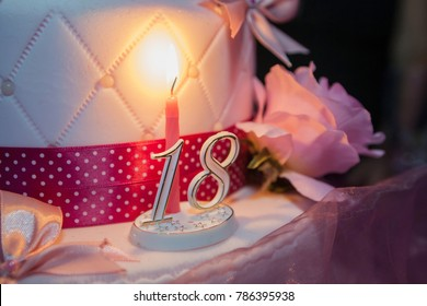 Eighteen years birthday. Cake with burning candle
