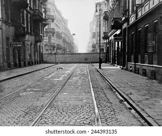 Eight-foot high concrete wall encircling Jewish ghetto in German occupied Warsaw, Poland, during World War II. Enclosing 500,000 Jews, the wall surrounded more than 100 city blocks. 1940.