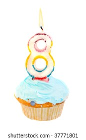 eighth birthday cupcake with blue frosting on a white background