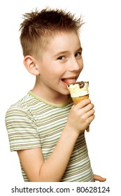 Eighth year boy eating ice cream isolated on white