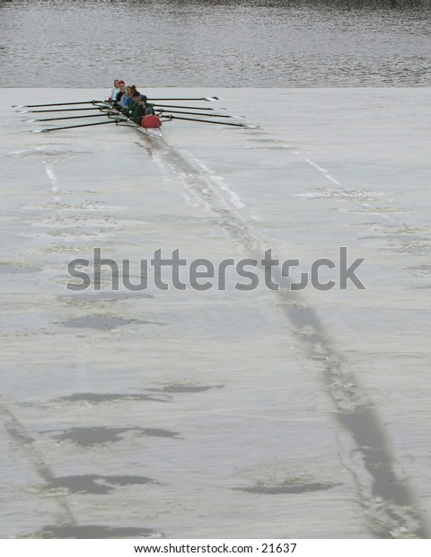 eight-oared racing shell practicing in cold weather