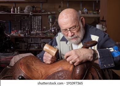 An eighty year old saddle repairman working at his craft.