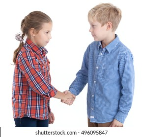 Eight-year Caucasian girl and boy shaking hands, isolated white background