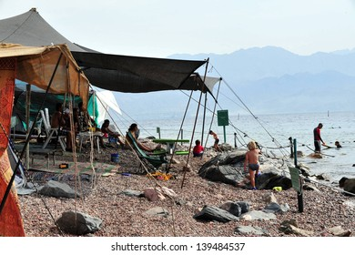 EILAT, ISR - OCT 16:Israeli people in camping tents on October 16 2018.Camping in Israel has recently  become a popular vacation for the young and for families