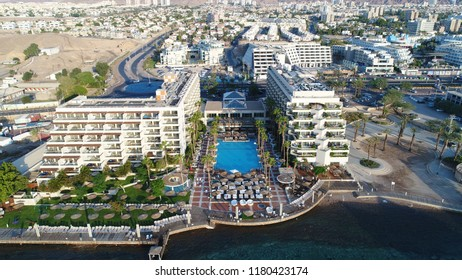 eilat israel drone aerial view of beach and tourism area in summer day with sea and urban city skyline with local airport and sea port