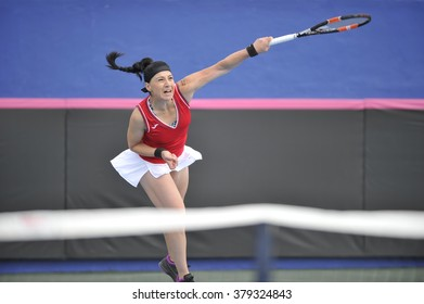 EILAT, ISRAEL - FEBRUARY 05, 2016: Professional tennis player Ekaterine Gorgodze from Georgian national team in action during the BNP Paribas FedCup game 2016 at Eilat Tennis Center in Israel