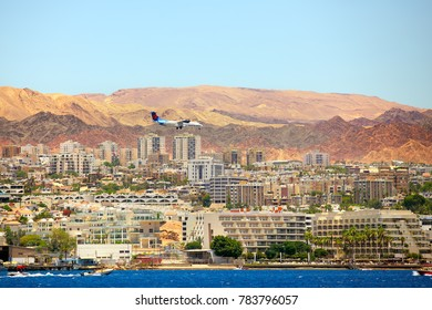 Eilat, Israel - JUNE, 23, 2017: 4X-ATH Israir Airlines ATR 72-500 from Tel-Aviv to Eilat. Landing in Eilat above houses with red roofs. Edom mountains on background