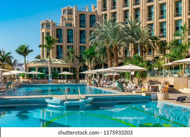 EILAT, ISRAEL- MARCH 05: Having fun in Hilton hotel's outdoor swimming pool on March 05, 2017 in Eilat, Israel. Famous resort of the Red Sea, on the Gulf of Aqaba.