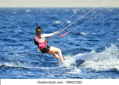 Eilat, Israel, March 11, 2016: Young woman kite-surfer in the gulf of Eilat.
