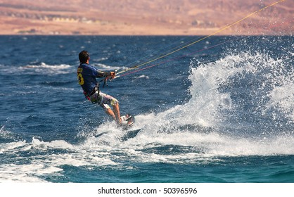 EILAT, ISRAEL - MARCH 31: Unidentified kitesurfer glides on water surface on Red Sea March 31, 2010 in Eilat, Israel.