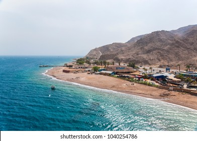 Eilat, Israel - May 14, 2012: View from the Tower of Underwater Observatory Marine Park in Eilat. Desert mountains with park areas and border with Egypt on horizon.