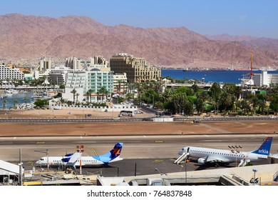 Eilat, Israel - MAY 24: plane of israeli airline Israir, landed at the airport of Eilat on the background of luxurious hotels, Israel, on May 24, 2017 in  Eilat, Israel