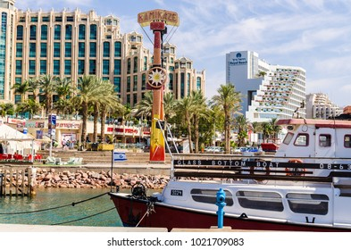 EILAT, ISRAEL – November 7, 2017:  entrance to marina, with promenades, modern hotel complexes, palms, boats, cafes, restaurants and shopping centers. Eilat - famous resort and recreational city in Is