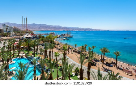 Eilat, Israel-April 23, 2018: Aerial view on the Red Sea, central public beach and promenade in Eilat - famous vacation spot,  resort and recreational city in Israel and Middle East