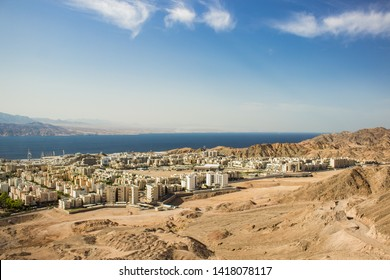 Eilat Israeli city street aerial photography of villa and cottage living district on the edge of desert and Gulf of Aqaba Red sea bay background view, Middle East scenic landscape picture