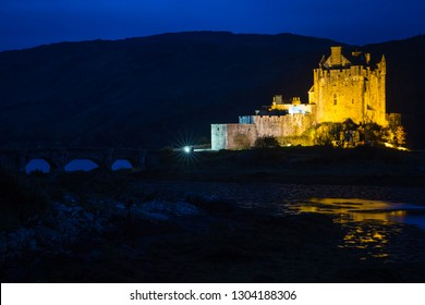 Eilean Donan Castle by the river in Scotland shot at blue hour near Isle of Skye, UK.