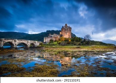Eilean Donan Castle, Scotland, reflecting itself into the water during evening.