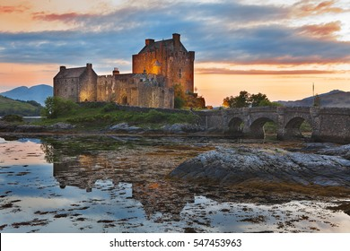 Eilean Donan Castle, Scotland, reflecting itself into the water during evening. UK.