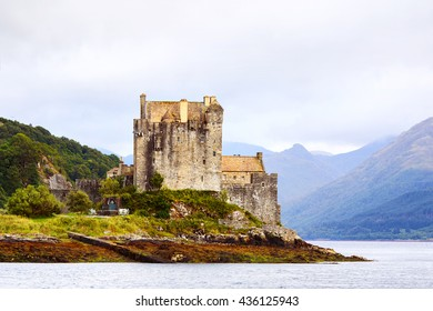 Eilean Donan castle Scotland. Side view of the famous Scottish castle with mountains in the bacground. UK