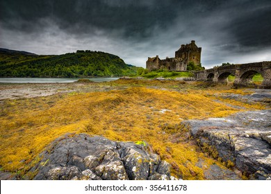 Eilean Donan Castle in Scotland, United Kingdom on a dark, overcast day.