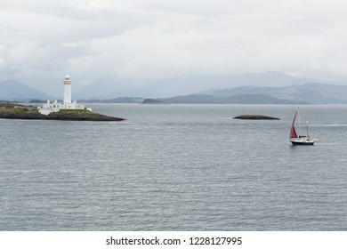Eilean Musdile Lighthouse and Sailing boat