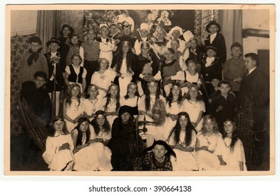 EILENBURG, GERMANY - CIRCA 1950s: Vintage photo shows pupils to pose after theatre performance. Black & white photo.