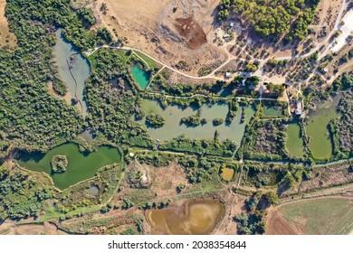 Ein Afek nature reserve catfish swamp and bridge, Aerial view. - Shutterstock ID 2038354844