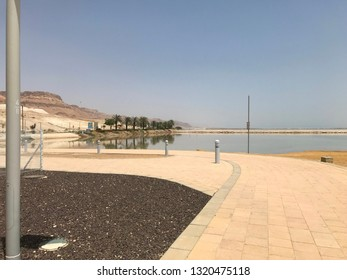 EIN GEDI, DEAD SEA, ISRAEL - MAY 11, 2018: The beach at Ein Gedi, Dead Sea, Israel. The popular tourist attraction is the lowest point on Earth.