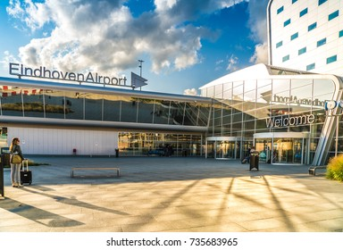 Eindhoven August 19th 2017: Exterior of the terminal of Eindhoven Airport with passengers entering and leaving